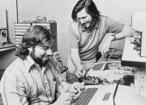 Steve Jobs and Steve Wozniak working on BASIC programming on the Apple II.